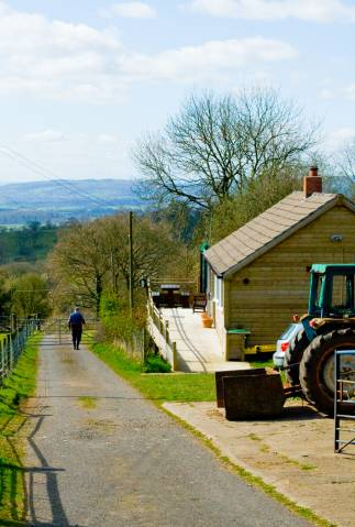 Farmer in Lane with panoramic view of Shropshire